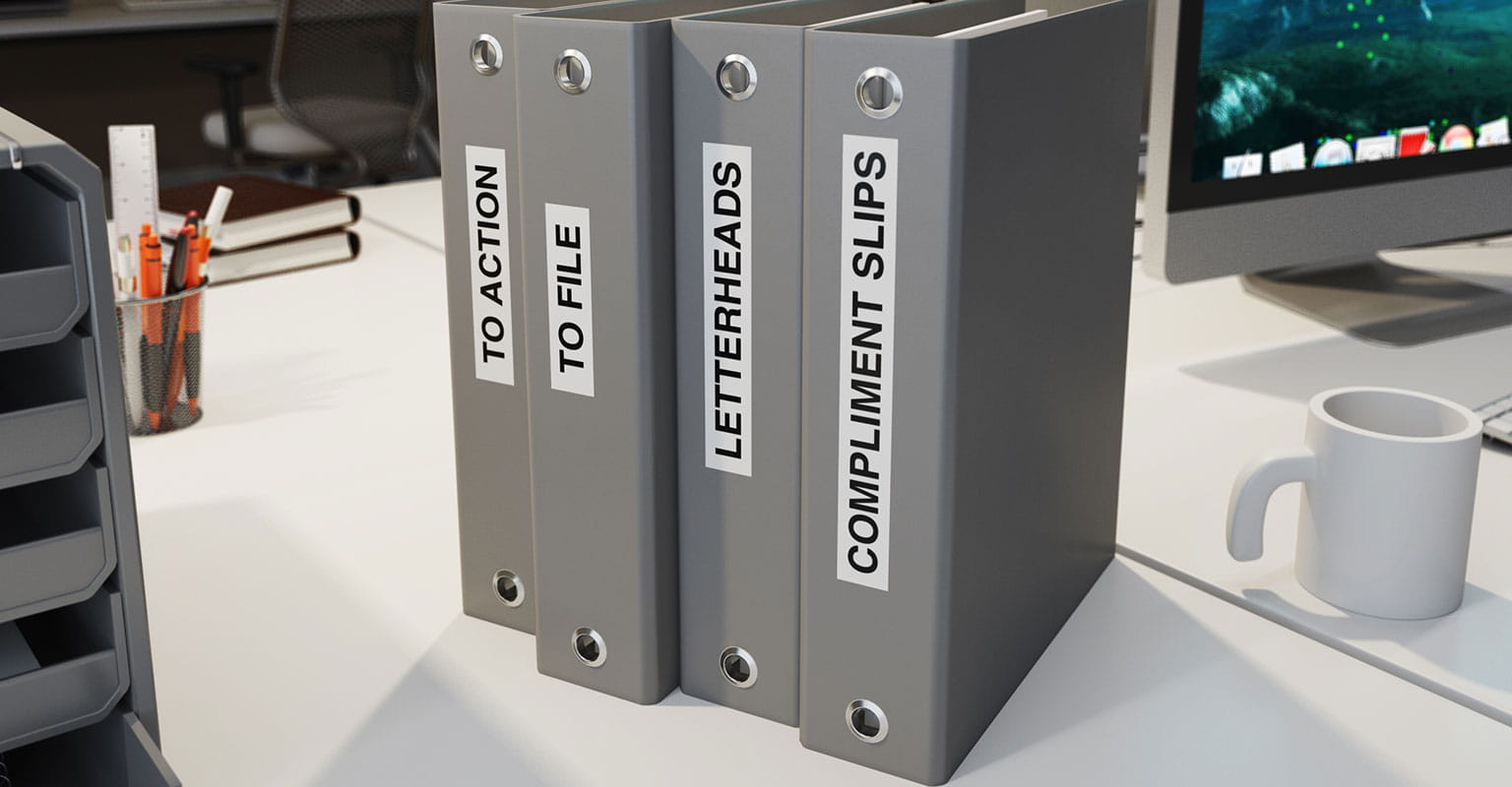 Four file folders with Brother P-touch labels on spine identifying the contents of the folders