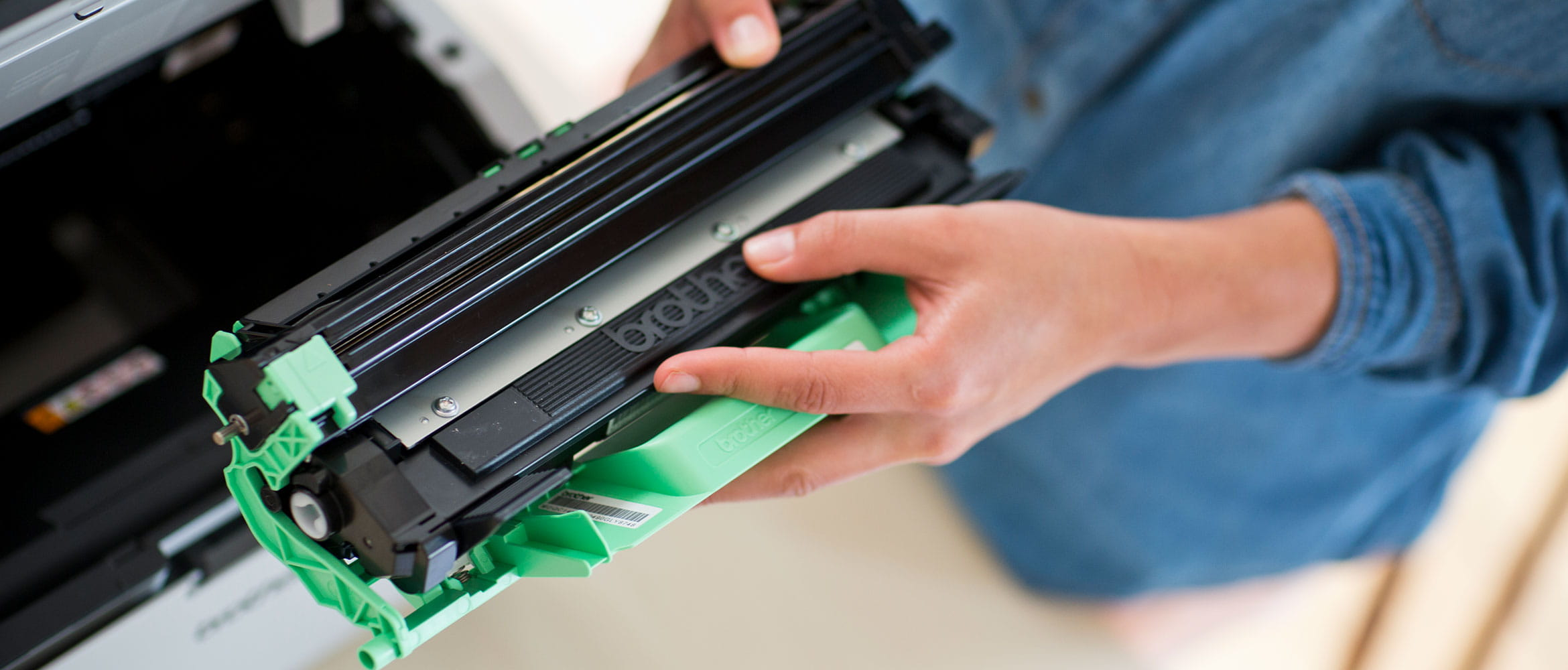 A man holding a Brother toner cartridge