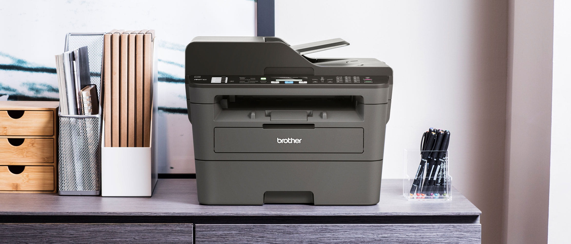 Black Brother printer situated on a desk