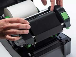 Монтаж та термотрансферна мастилена лента в принтер TD-4D